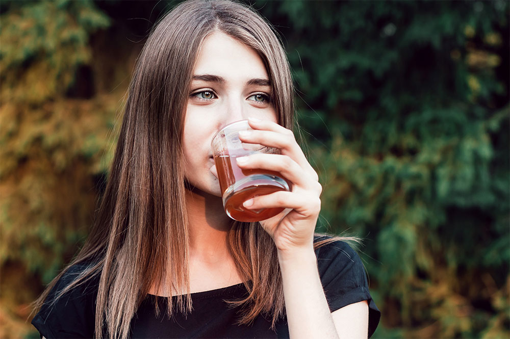 Image of person drinking fruit juice