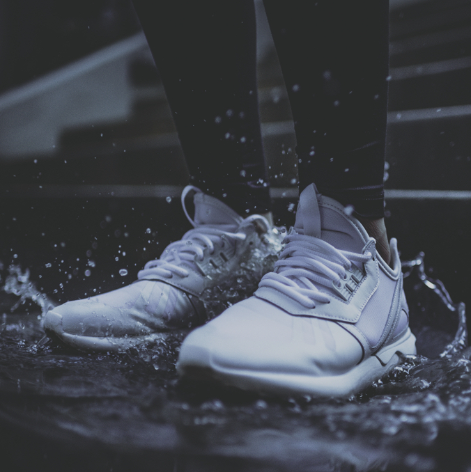 Image of person wearing trainers in the rain