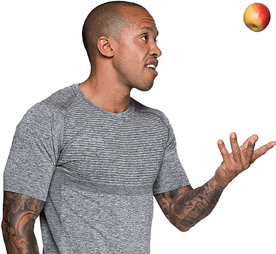 Image of Liverpool Street based personal trainer Jason Jackson catching an apple