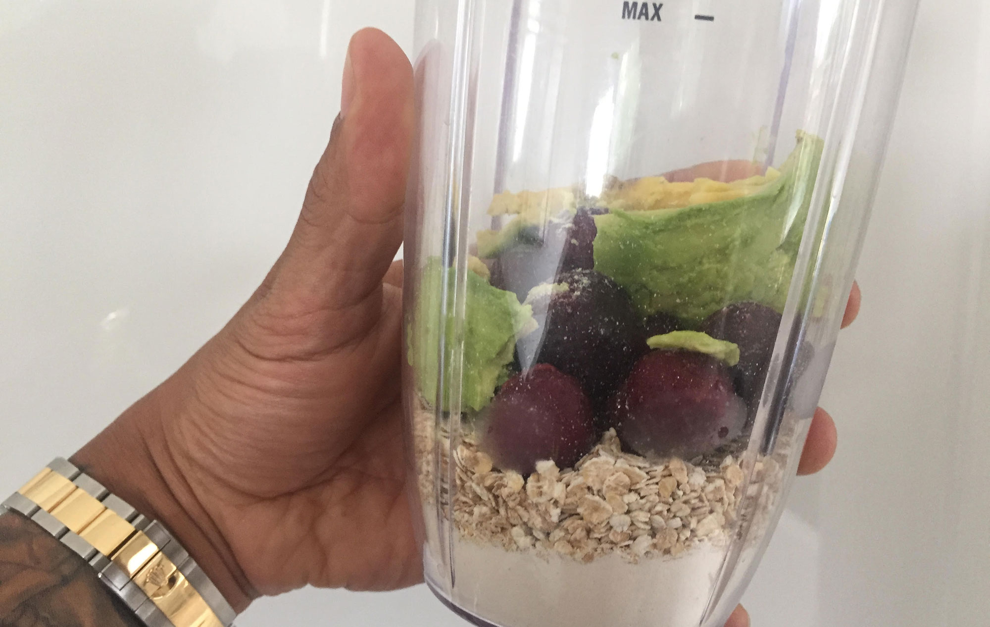 Image of Liverpool Street personal trainer holding a protein smoothie